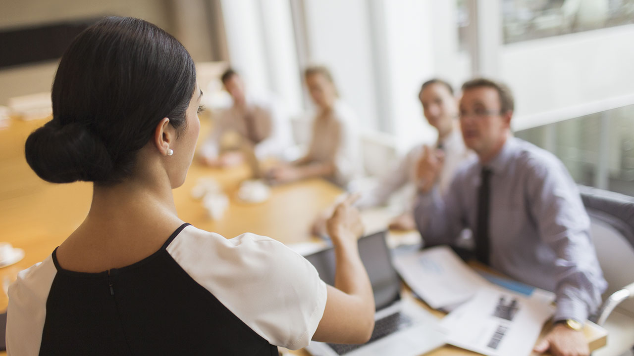 woman leading meeting in conference room