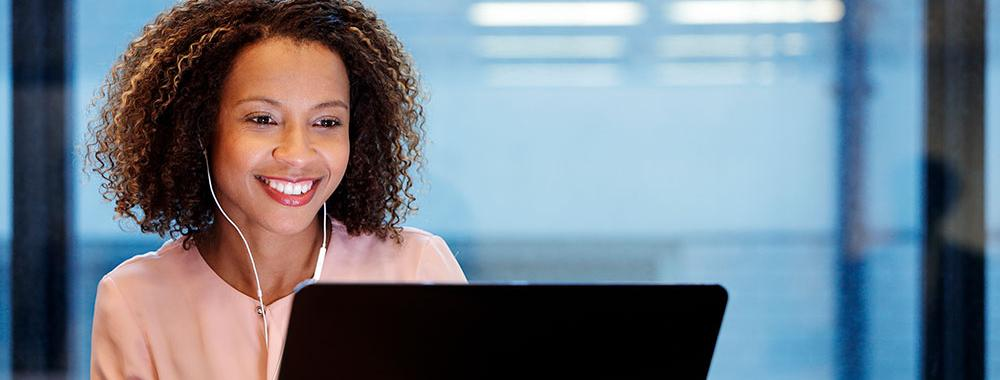 smiling woman using laptop computer