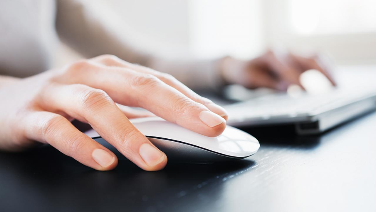 close up of person clicking on mouse