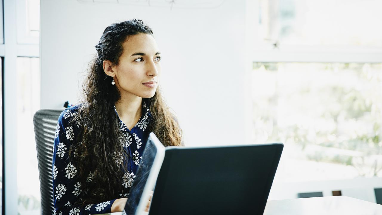 female professional sitting at computer