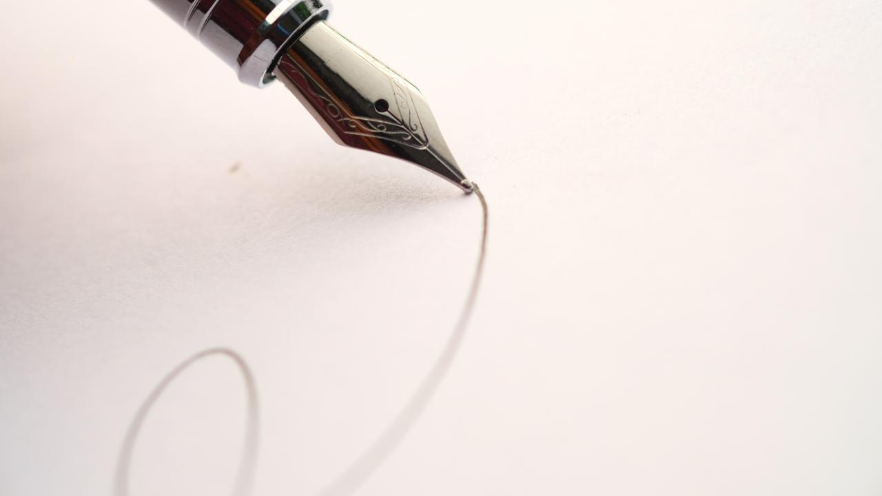 close up of pen writing script